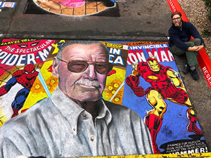 Posing with Stan Lee Marvel tribute pavement art