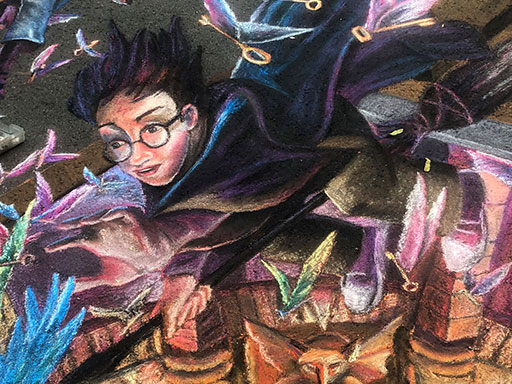 Working on Harry Potter and the Philosopher's Stone book illustration pavement chalk art