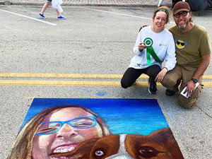 Posing with girl with australian shepherd corgi dog chalk art