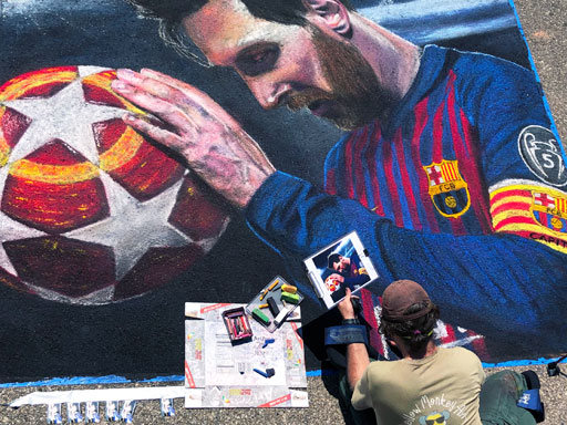 Working on Lionel Messi pavement chalk art
