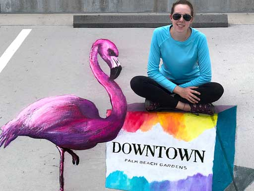 Posing with 3D flamingo pavement chalk art for Downtown Palm Beach Gardens