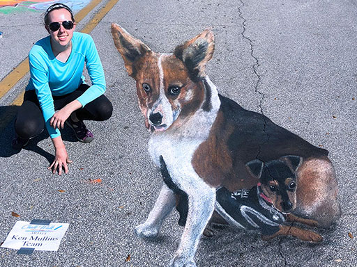 Posing with 3D dogs chalk art