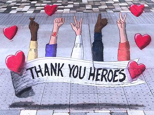 Thank You Heroes pavement chalk art to honor healhcare workers