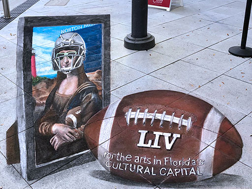 3D Mona Lisa in a football helmet chalk art